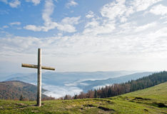 Cross on mountain stock images