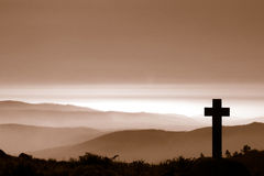 Cross in mountain. With fog Stock Photography