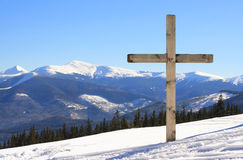 Cross on the mountain. Wooden cross on the top of the mountain near the forest royalty free stock images