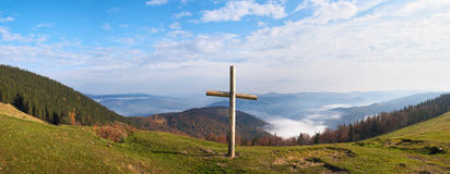 Cross on mountain. Wood cross on fall mountain plateau. Four shots composite picture. Jaremche-Town outskirts, Ivano-Frankivsk Region, Ukraine Royalty Free Stock Photos