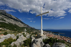 Cross on the mountain above Makarska. Cross on a hill above the town of Makarska and sea views Royalty Free Stock Photography