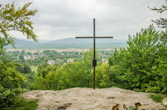 Cross on the mountain cave monastery at the foot of the Carpathians Rozhirche Stock Images