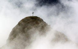 Cross on a Mountain with Clouds Royalty Free Stock Image