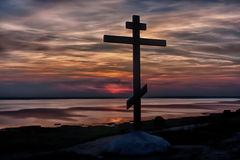 Cross on the mountain. In decline beams Stock Photos