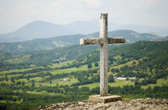 Cross on the mountain Stock Images