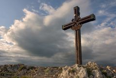Cross on a mountain peak. A wooden cross on a European mountain peak, with nice evening sunlight royalty free stock photo