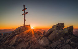 Cross on Mountain Peek at Sunset royalty free stock images