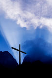 Cross in mountain at sunrise. Silhouette of Christian cross at sunrise or sunset vertical image royalty free stock photography