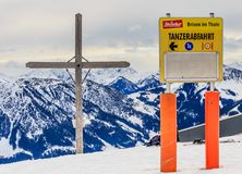 Cross on the mountain Zinsberg. Ski resort Brixen im Thalef Royalty Free Stock Image