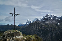 Cross and Mountains, Switzerland Royalty Free Stock Images