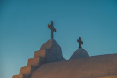 Cross at Mykonos. Cross at church of Panagia paraportiani during sunset Royalty Free Stock Photos