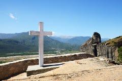 The cross is near Monastery of Holy Trinity Stock Image
