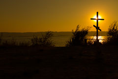 Cross near the water Stock Images