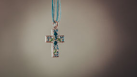 Cross necklace pendant. Christian religion faith. Royalty Free Stock Image