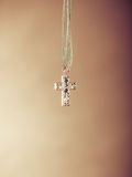 Cross necklace pendant. Christian religion faith. Stock Photography