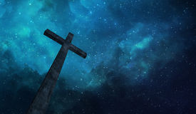 Cross and night sky. A single wooden cross before a starry sky Stock Photo
