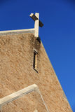 Cross on old church. Cross on top of old brick church with deep blue background Royalty Free Stock Photography
