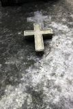 A cross in a old grave in Paris Stock Image