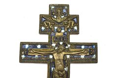 Cross old orthodox copper on white isolated background stock image
