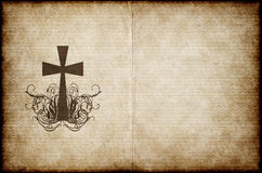 Cross on old parchment. Cross on old worn and grungy parchment paper Stock Images