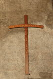 Cross on a old stucco wall with inscription on italian Royalty Free Stock Images