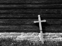 Cross at an old wooden church - BW. In an old wooden mountain village Royalty Free Stock Photo