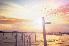 Free Cross On Blurry Sunset Background Stock Image - 120969511