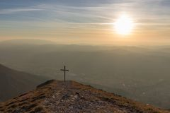 Cross On Top Of Mt. Serrasanta Umbria, Italy, With Warm Golden Hour Colors And Sun Low On The Horizon Royalty Free Stock Images