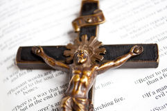 Cross on open bible - macro shot - Royalty Free Stock Photo