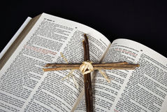 Cross on open Holy Bible Stock Photos