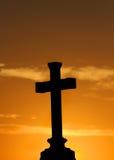 Cross with orange sunset Royalty Free Stock Photos