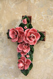 Cross ornament with ceramic flowers in France Stock Image
