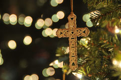 Cross ornament on christmas tree Royalty Free Stock Images