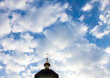 The cross of the orthodox Christian church against the cloudy sk. Y background Royalty Free Stock Photos
