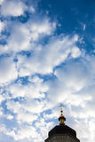 The cross of the orthodox Christian church against the cloudy sky. Background Stock Photography