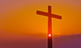 Cross over beautiful sunset background with Copy Space. Christian cross at sunrise or sunset concept of religion stock image