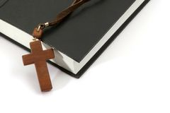 Cross over a bible. Isolated on white background Royalty Free Stock Image