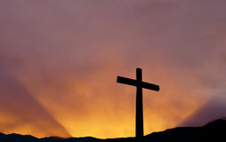 Cross over bright sky background. Christian cross over beautiful sunset background concept of religion royalty free stock images