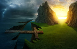 Cross over the chasm. A cross forms a bridge over the cliff into a bright landscape Royalty Free Stock Images
