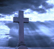 Cross over cloudy sky. Perfect religious background Royalty Free Stock Image