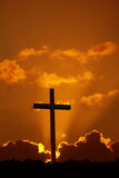 Cross over dramatic sunset. Christian cross over dramatic sunset vertical image royalty free stock image