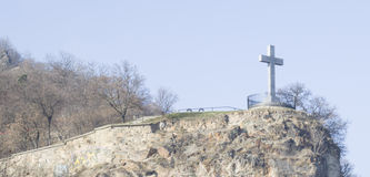 The cross over the hill. The cross of Jesus over the hill Royalty Free Stock Image