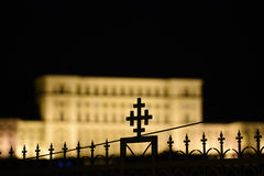 Cross over the Parlament palace in Bucharest Royalty Free Stock Photos