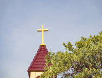 Cross over roof Christian Stock Image