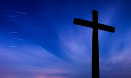 Cross over starry sky background concept of religion Stock Photography