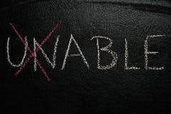 Cross over unable word on black chalkboard Stock Photography
