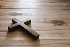 Cross over wood table Stock Photo