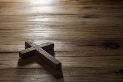 Cross over wood table. With window light stock photo