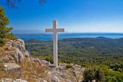 Cross overlooking islands of Croatia Stock Photo