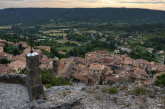 Cross on a path to a church above above small Provencal town Stock Photography